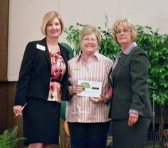 CTHC Educator Philonda Heilaman, center, accepts the Great Expectations Model School award in 2011 at the annual GE conference in Oklahoma.
