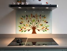 This lovely bespoke glass splashback found a home in Bambury, Oxfordshire. It's a Tree of Life that puts a unique spin on the classic design, with both the trunk and the branches created out of a deep, natural brown colour. A white background provides a solid base for the colours to shine, especially with leaves proudly sprouting complementary colours and accents. Glass Wall Art, Fused Glass Art, Glass Kitchen, Kitchen Art, Custom Glass, Bespoke Kitchens, Splashback, Panel Art, Finding A House