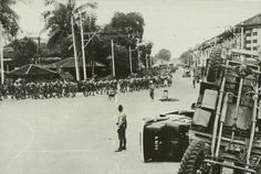 """British troops marching along Serangoon Road after the British surrendered to the Japanese on February 15, 1942. Singapore, the crown colony and """"Impregnable Fortress"""", fell after just 7 days of battle. (Text from http://sg.sg/GGYm97 and Wikipedia http://bit.ly/GLR4W3)"""