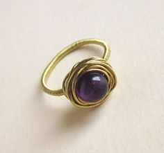 Ring with a purple eyelet from EyeBright by DaWanda.com
