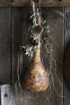 gourd and dried sunflowers