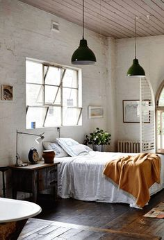 Industrial pendant lights in the bedroom of artist Saskia Folk's Melbourne home in a former factory. Photo: Derek Swalwell. Stylist: Heather Nette King