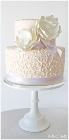 Wedding Color Palette: Opalescent ~Wedding Cake in Soft Peach, Lavender and Ivory with Detailed Scroll Work. Featuring Sugar-Paste Magnolias  by The Pastry Studio