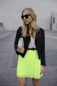 Flowy neon skirt with cool jacket and sparkly clutch!