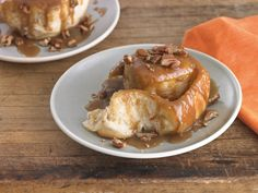 Today, on National Sticky Bun Day, try these decadent treats, which reach new heights with a warm, extra-gooey caramel sauce poured on just before serving. You'll probably want a fork and a knife t...