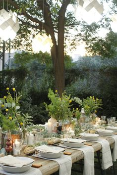 Take it outside! Set a beautiful outdoor table with candles and natural flowers.