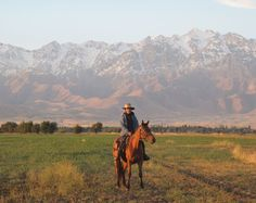 Endurance rider Megan Lewis riding on hourseback from Beijing to London, photographed in front of the Zailisky Mountains, Kazakhstan (2012 Olympics Silk Road connection!)