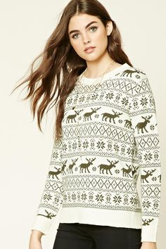 A midweight knit sweater featuring a fair isle pattern with moose and snowflakes, a round neckline, long sleeves, and contrast ribbed trim.
