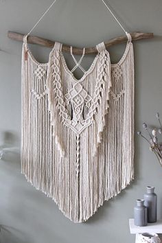 This unique piece is made by hand using natural unbleached cotton rope. The used wood is a treebranche found on the North Seacoast of the Netherlands and its surrounded dunes/forest area. The branch is cleaned and sanded where needed. Macrame wall hanging From The Roots Handmade Unique