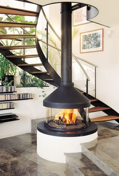 34 The Best Modern Fireplace Design Ideas - Home Bestiest Suspended Fireplace, Hanging Fireplace, Freestanding Fireplace, Electric Wood Burning Stove, Electric Fireplace, Custom Fireplace, Home Fireplace, Fireplace Ideas, Simple Fireplace