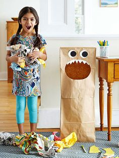 Turn two grocery bags into a friendly monster that wants nothing more than to be fed with paper scraps. Once it's full, pack up the whole shebang and send it to the recycling center. Cut a large oval hole in a large brown paper bag. Use a glue stick to attach a row of pointy, white paper teeth inside. Add paper eyes. Open a second paper bag and slip the first bag over it, overlapping the edges an inch or two. Seal the seam with masking tape.                 Originally published in the April…