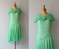 Vintage 1920s spring green silk chiffon dress with ruffled capelet collar and small flower, asymmetrical dropped waist and swishy skirt. Closes with
