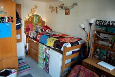 dorm room. I never would have thought to put the fridge under the bed