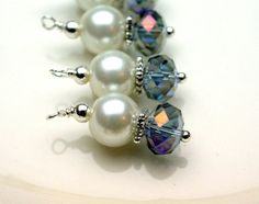 4 Piece White Pearl and Mystic Purple Rondelle by bountyofbeads, $5.00