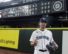 Seattle Mariners starting pitcher Hisashi Iwakuma tosses a baseball as he poses for a photo in front of the manual scoreboard at Safeco Field after he threw a no-hitter against the Baltimore Orioles in a baseball game Wednesday, Aug. 12, 2015, in Seattle. The Mariners won 3-0. (AP Photo/Ted S. Warren) ▼13Aug2015AP|Hisashi Iwakuma's gem finally ends AL no-hitter drought http://bigstory.ap.org/article/92c24278cba04271ad2d7798aa4a4390