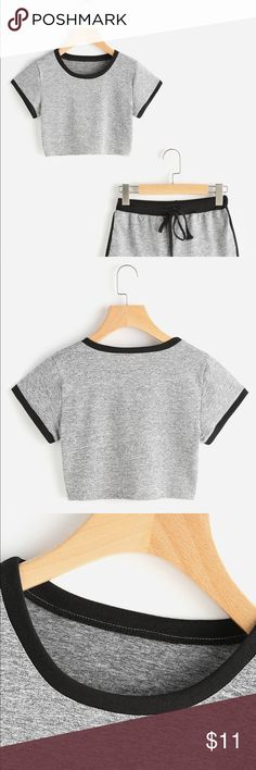 NWOT ROMWE Ringer Crop Tee This heather gray cropped tee is super cute and has nice contrast.  The material has a slight stretch and is very comfy.  Black trim around neckline and sleeves.  The first few pictures are how the color looks.  I'll retake my pictures tomorrow with better lighting.  Tags have been taken off, but it is brand new and has never been worn.  • New without tags • Size: Small • Color: Grey/Black • Cropped  • Round Neck • 35% Cotton 65% Polyester ROMWE Tops Tees - Short…
