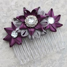 Hey, I found this really awesome Etsy listing at https://www.etsy.com/listing/219162195/flower-hair-comb-deep-purple-hair