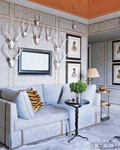 High gloss Hermès orange ceiling, antlers, wallpaper