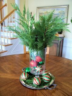 Lush Christmas tree branches in wooden vases as centerpieces on Dinner tables at Snow White Party.