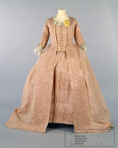 Dress: ca. 1720-1780, silk, petticoat and buttoning compere trimmed with self frills and furbelows.