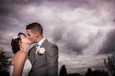Wotton house wedding photography beautiful dramatic clouds purple kiss romantic