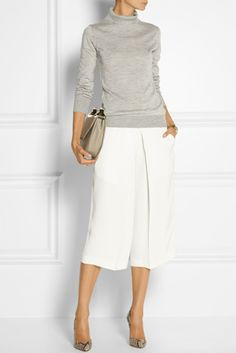 Fashion: Spring / Summer. White crepe culottes with pointed toe pumps.