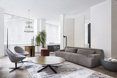 MERIDIANI I NORTON sofa I JO small armchairs I MILLER low table I GONG dining table I LALIT rugs
