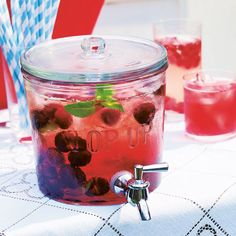 Top Up Drinks Dispenser - http://www.FancyGiving.com - Fill this gorgeous dispenser with cocktails, juice or flavoured water and it will be the star of your summer parties. When it's time for a top-up, just turn the tap to charge your glasses. Designed for stacking, you can put them together to create a multi-flavoured drinks fountain too! Comes with recipes for two cocktails and two mocktails.