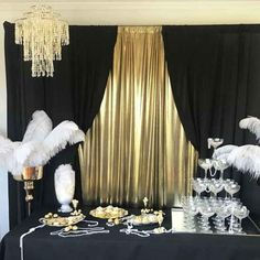 The Gatsby party package is an ideal choice for a very special occasion; combining glitz, glam and classic elegance for a swinging good time! Feather Centerpieces, Bottle Centerpieces, Roaring 20s Theme, Great Gatsby Themed Party, Black Tablecloth, Gold Backdrop, Hanging Chandelier, Masquerade Party, Gold Party