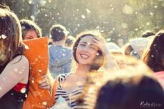 BCN Pillow Fight | young pretty lady amougs a rain of feathers