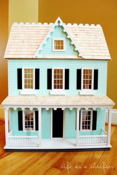 I am absolutely in love with this dollhouse!! I foresee a time-consuming Christmas gift in my future...