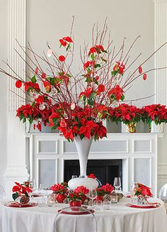 Red tablescape Red themed wedding #red #sashes #flowers #chaircovers #tablerunner #white #spring #hotcolors #favorites visit is at www.chaircoverfactory.com