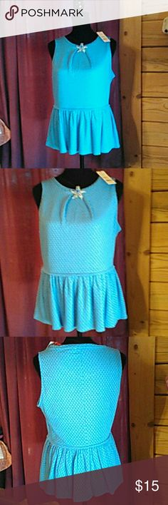 Shirt Elle NWT FROM Kohl's. Beautiful peplum sleeveless shirt. Size medium. Great for summer and winter with a sweater! Elle Tops Blouses