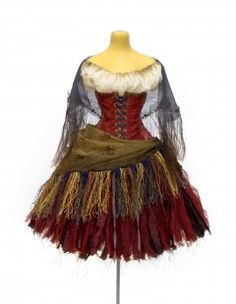 Miniature Carmen costume from the Royal Opera House. This costume has a practical corset made from period and contemporary silks. The underskirt is made from multiple shot silk ribbons, shaded into the waist and hem, and overlaid with distressed silk tulle.