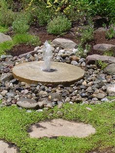 A millstone fountain sounds relatively easy to make. Check it out!