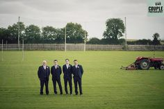 The groomsmen make a quick stop off at their local GAA club for a few photos! Weddings at Cabra Castle by Couple Photography.
