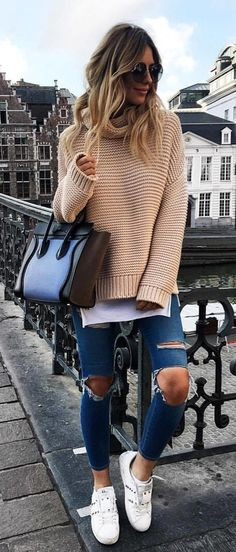 #fall #outfits women's beige long-sleeve sweater with distressed fitted jeans and pair of white shoes