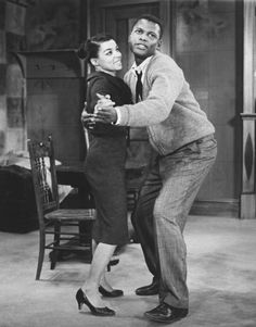 Director Sidney Poitier is seen with Ruby Dee in a scene from 'A Raisin in the Sun.'