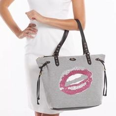 """Juicy Couture Sport Tote Juicy Couture JC Sport Lips Sweatshirt Tote. This colorful tote is accented with rhinestones on the tote's lips which add a trendy fashion to it. Perfect for that special Valentine! It is made of a sweatshirt type material and with leather straps. Great gym bag!   Features: Rhinestone accented lips Sweatshirt fabric construction Product Details 12.5''H  x 18''W x 5"""" 'D Approximate drop down length: 9'' Shoulder straps Zipper closure Interior: zip pocket & 2 slip…"""