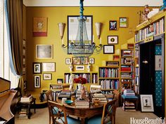Bookshelves built-in to a staircase. Design: Brockschmidt & Coleman. Photo: Simon Watson. housebeautiful.com. #dining_room #library #chandelier #antique #bookshelves