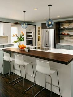 Love this kitchen! I love the Butchers block bar counter + the color scheme