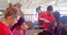 Bhutanese students share their culture with our staff.  Here they are teaching us to make samosas.