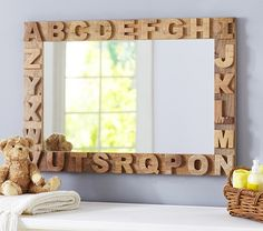 Love this rustic baby mirror that can go with just about any nursery. ABC Mirror   Pottery Barn Kids #babygirl #carouseldesigns