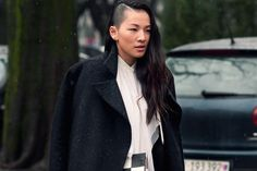 androgynous look: black coat, white top, shaved + long hair