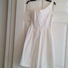 ZARA white one- shoulder dress Beautiful White dress with boning to provide structure and support and a good fit..this is the season to show off your shoulders ;) fully lined throughout.. Hidden side zipper.. In good condition Zara Dresses One Shoulder