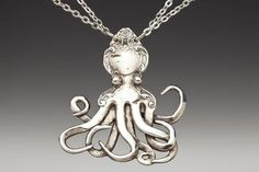 Octopus Silver Spoon Necklace: The swirling tentacles of this shiny cephalopod are made from the prongs of two forks. The head is inspired by an ornate spoon handle from the late 1800's.