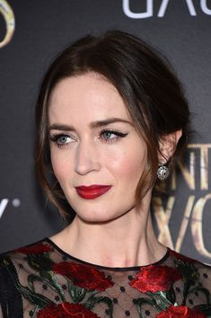 Messy Updo - Emily Blunt's messy updo is an effortless style for holiday gatherings.