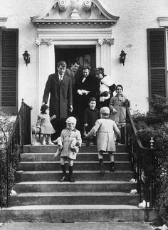Bobby Kennedy  and wife Ethel with their children on their way to the christening of their son Michael.  Teddy Kennedy is the godfather. 1958