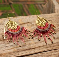 Brass spiral earring with woven cotton cord in by cafeandshiraz