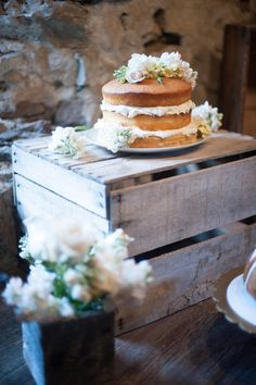 naked wedding cake with floral accents #weddingcake #nakedcake #weddingchicks http://www.weddingchicks.com/2014/02/04/cowgirl-wedding/